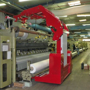 Insertion of sectional warp beams in warp-knitting machines